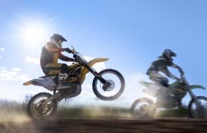 Motocross rider pulling a wheelie